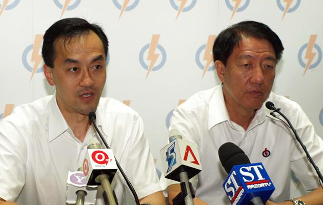 A sombre Dr Koh and DPM Teo at the PAP post election press conference