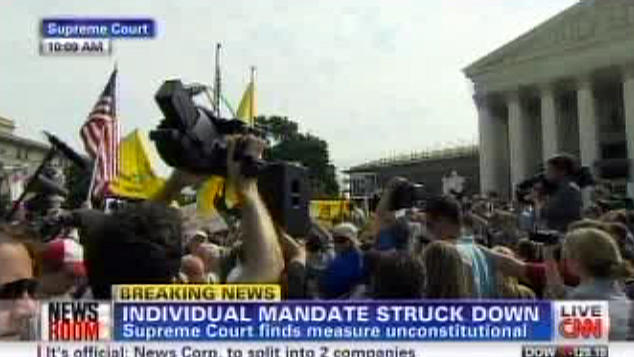 This television frame grab shows CNN broadcasting the Supreme Court's decision incorrectly on President Barack Obama's health care law on Thursday, June 28, 2012. Both CNN and Fox News Channel incorrectly reported Thursday that the law's central provision, requiring virtually all Americans to have health insurance, had been struck down. Both networks backtracked when it became clear that the court upheld the provision. Broadcast networks broke into regular programming to deliver special reports and generally got it right. To get the news out quickly, competitive news organizations had to wade through pages of legal writing. (AP Photo)