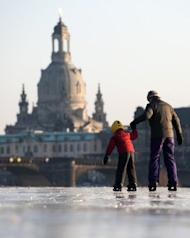 A young boy and his mother skate on the partly frozen river Elbe in Dresden in February. German parents who do not send their under-three-year-olds to a state-sponsored nursery will receive 100 euros ($132) a month from next year, increasing to 150 euros from 2014