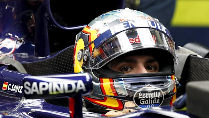 Toro Rosso Formula One driver Carlos Sainz of Spain sits in his car during the second practice session of the Russian F1 Grand Prix in Sochi