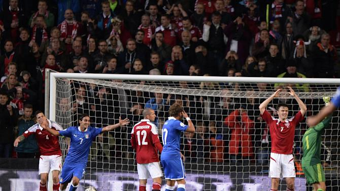 Italy's Alberto Aquilani, second from left, celebrates his goal in overtime next to Denmark's Danial Agger, left, Leon Andreasen, third from left, and Willam Kvist during the 2014 World Cup Group B qualifying soccer match between Denmark and Italy at Parken Stadium in Copenhagen, Denmark, Friday Oct. 11, 2013