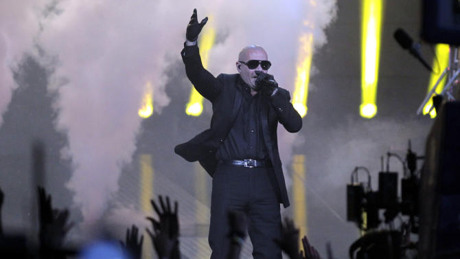 "FILE - In this Feb. 26, 2012 file photo, rapper Pitbull performs during the half time show of the NBA All-Star basketball game, in Orlando, Fla. Pitbull will be coming to Alaska. Over the last few weeks, Walmart has been running a marketing contest on its Facebook page. The store that got the most ""likes"" wins a personal appearance from Pitbull, aka Miami rapper Armando Christian Perez. A writer for The Boston Phoenix newspaper thought it'd be funny to send Pitbull to the most remote Walmart possible, and encouraged people to pick the Walmart in Kodiak _ which wound up with more than 70,000 ""likes."" (AP Photo/Chris O'Meara, file)"