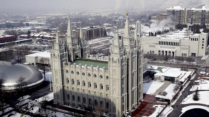 "This Jan. 22, 2013 photo shows the Salt Lake Temple, at Temple Square, in Salt Lake City. Mormon church officials and Boy Scout leaders in Utah applauded the Boy Scouts of America for putting off a decision Wednesday on lifting its ban on gay members and leaders. The policy under consideration would let troop sponsors make their own decisions about leaders and youth members. Boy Scouts of America ""acted wisely in delaying its decision until all voices can be heard on this important moral issue,"" said Michael Purdy, spokesman for The Church of Jesus Christ of Latter-day Saints. The church will continue to closely monitor the proposed policy change, Purdy said. (AP Photo/Rick Bowmer)"