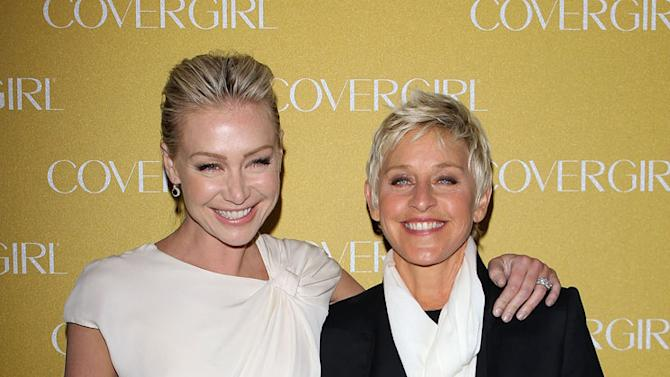 Portia de Rossi and Ellen DeGeneres arrive at COVERGIRL Cosmetics' 50th Anniversary Party held at BOA Steakhouse on January 5, 2011 in West Hollywood, California.
