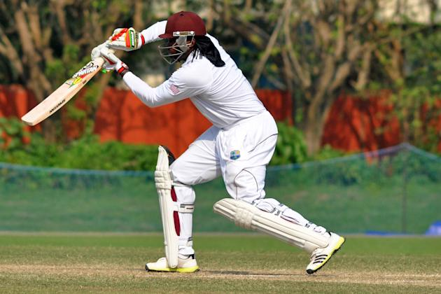 West Indies player Chris Gayle in action during Day 3 of practice match between West Indies and Uttar Pradesh Cricket Association XI at the Jadavpur University Ground in Kolkata on Nov.2, 2013. (Photo