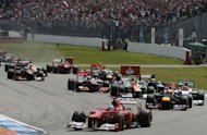 Ferrari's Spanish driver Fernando Alonso leads after the start of the at the Hockenheimring circuit during the German Formula OneGrand Prix. Alonso extended his lead in this year's Formula One drivers' world championship on Sunday when he drove to a flawless victory for Ferrari in the German Grand Prix