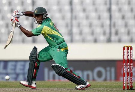 Bangladesh's Kayes plays a ball against Pakistan during their Asia Cup 2014 ODI cricket match in Dhaka