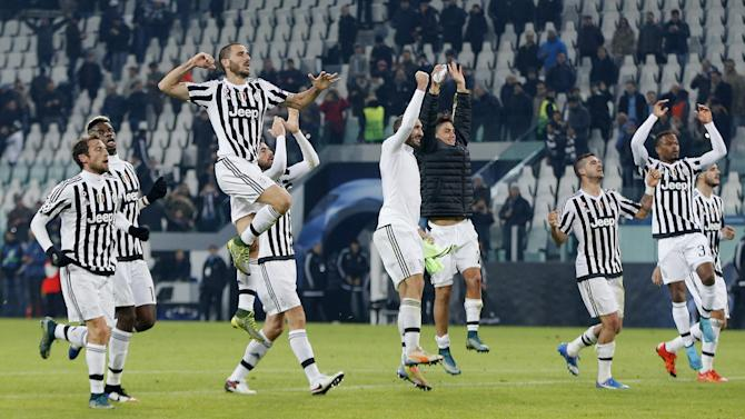 Juventus' players celebrate after the match