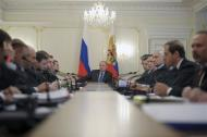 Russia's President Vladimir Putin attends a meeting with members of the government at the Novo-Ogaryovo state residence outside Moscow, March 19, 2014. REUTERS/Alexei Druzhinin/RIA Novosti/Kremlin