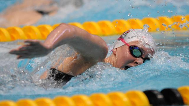 Swimming - Carlin completes golden hat-trick in Leeds