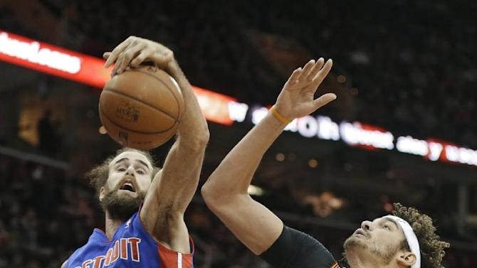Detroit Pistons' Luigi Datome (13), from Italy, tries to grab a rebound against Cleveland Cavaliers' Anderson Varejao (17), from Brazil, during the second quarter of an NBA basketball game Monday, Dec. 23, 2013, in Cleveland