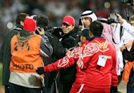 "Mahdi Ali (C), coach of the UAE team, is congratulated after his team beat Kuwait at the Gulf Cup on January 15, 2013. ""Iraq are very tough opponents but our team has improved to a higher level in each match. We are ready,"" Ali said of Friday's clash against Iraq"