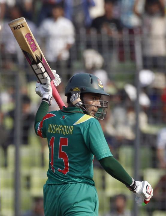 Bangladesh's captain Mushfiqur Rahim celebrates after scoring a half century against New Zealand during their first ODI cricket match in Dhaka