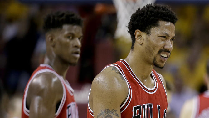 Chicago Bulls guard Derrick Rose (1) reacts during the second half of Game 1 against the Cleveland Cavaliers in a second-round NBA basketball playoff series Monday, May 4, 2015, in Cleveland. The Bulls won 99-92. (AP Photo/Tony Dejak)