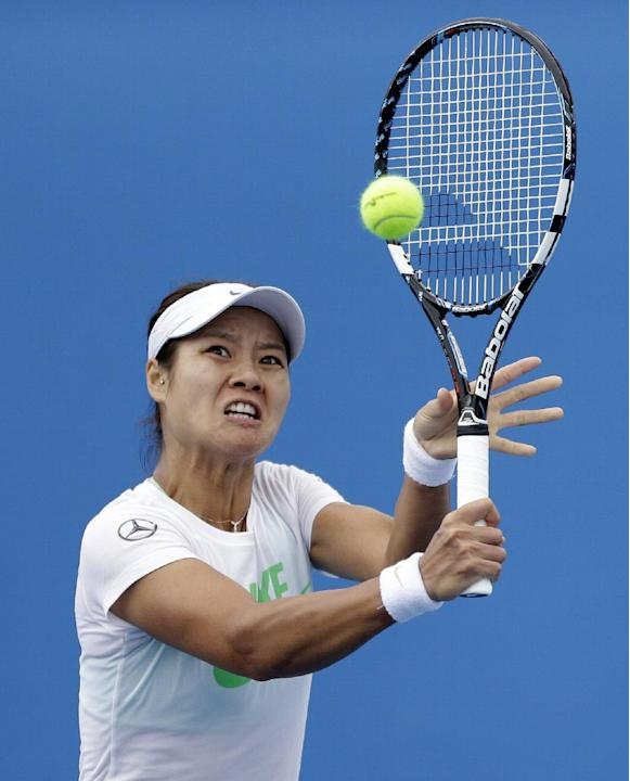 Li Na of China makes backhand return during a practice session ahead of the Australian Open tennis championship in Melbourne, Australia, Sunday, Jan. 12, 2014