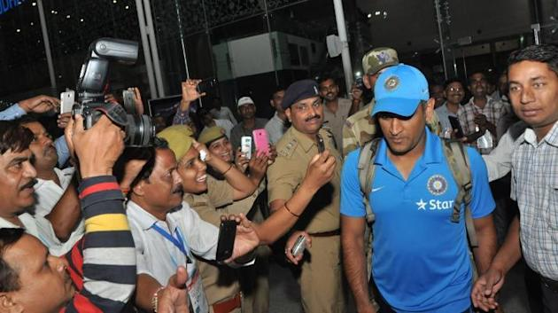 Lucknow: Indian cricket captain MS Dhoni arriving at Lucknow Airport for the Kanpur One-Day International match on Oct. 9, 2015. (Photo: IANS)