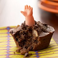 Buried Alive Muffins recipe: You will need plastic doll arms (available at party supply or craft stores) for the decorations.