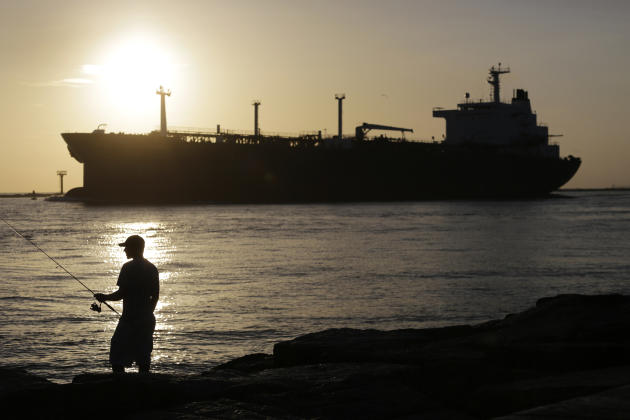 Oil prices slide as worries about global supply glut mount
