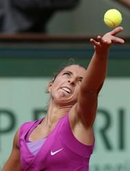 Italy's Sara Errani serves to Australia's Samantha Stosur during their Women's Singles semifinal tennis match of the French Open tennis tournament at the Roland Garr A lightweight presence in a heavyweight production, Errani has always had to punch above her weight