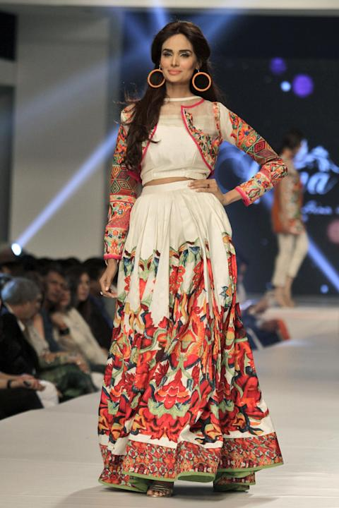 A model presents creations by Pakistani designer Hina Butt on the second-day of PFDC Sunsilk Fashion Week Spring/Summer 2015 in Lahore, Pakistan, Sunday, April 19, 2015. The Four-day long PFDC Sunsilk