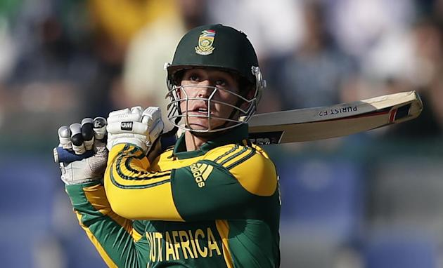 South Africa's wicketkeeper Quinton de Kock hits a shot during the fourth cricket one-day international match of a five match series between Pakistan and South Africa at the Zayed Cricket Stadium, in