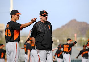 Pitcher Javier Lopez talks with Bruce Bochy during spring training workouts Thursday. (USA TODAY Sports)