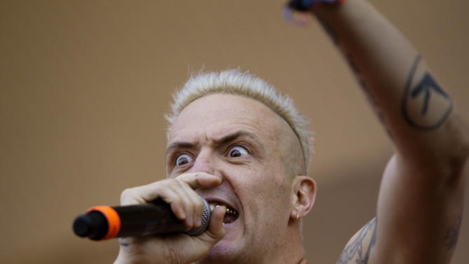 Ninja from Die Antwoord performs at Lollapalooza in Chicago's Grant Park on Friday, Aug. 3, 2012. (Photo by Sitthixay Ditthavong/Invision/AP)