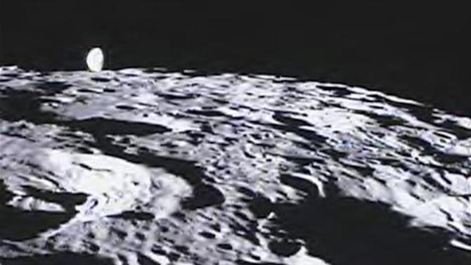 This image released by NASA on Thursday, March 22, 2012 shows the far side of the moon with Earth in the background. It was among more than 60 images taken by one of NASA's spacecraft in orbit around the moon. The cameras are operated by middle school students as part of a project. (AP Photo/NASA)