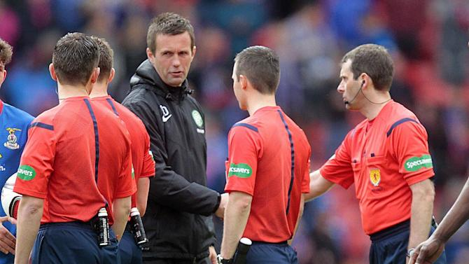 Football: Celtic manager Ronny Deila speaks with match officials at the end of the match