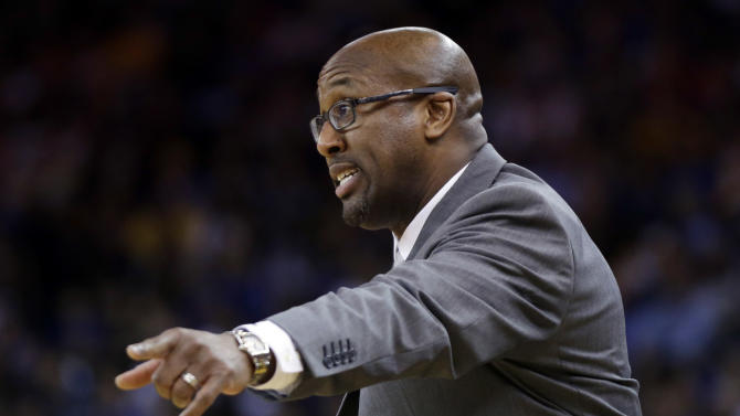 Cleveland Cavaliers coach Mike Brown talks to his players during the second half of an NBA basketball game against the Golden State Warriors on Friday, March 14, 2014, in Oakland, Calif. Cleveland won 103-94