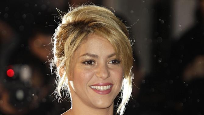FILE - This Jan. 28, 2012 file photo shows Colombian singer Shakira arriving at the Cannes festival palace, to take part in the NRJ Music awards ceremony, in Cannes, southeastern France. A spokesman for the 35-year-old Columbian singer says Shakira Mebarak and 25-year-old soccer star Gerard Pique of FC Barcelona welcomed son Milan Pique Mebarak on Tuesday, Jan. 22, 2013, at 9:36 p.m. in Barcelona, Spain. (AP Photo/Lionel Cironneau, file)
