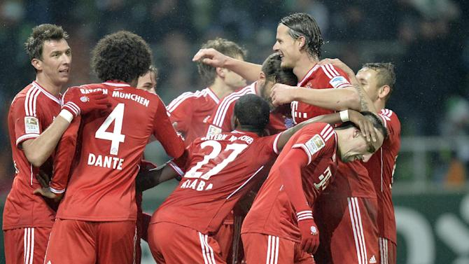 Bayern's team celebrates the 7th goal during the German Bundesliga soccer match between Werder Bremen and Bayern Munich in Bremen, Germany, Saturday, Dec. 7, 2013. Bayern defeated Bremen by 7-0
