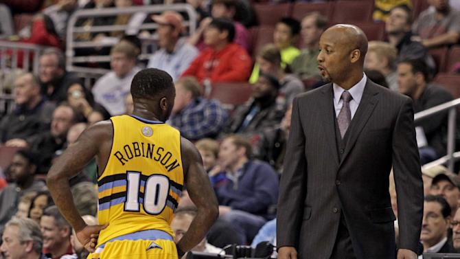 Denver Nuggets' Nate Robinson (10) talks to coach Brian Shaw as they play against the  Philadelphia 76ers in the first half of an NBA basketball game Saturday Dec. 7, 2013, in Philadelphia. The Nuggets won 103-92