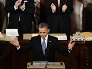 US President Barack Obama acknowledges applause before delivering his annual State of the Union address at the US Capitol on February 12, 2013 in Washington. AFP PHOTO/Paul J. Richards