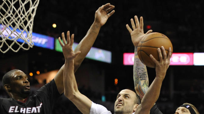 Duncan leads Spurs past Heat, 111-87