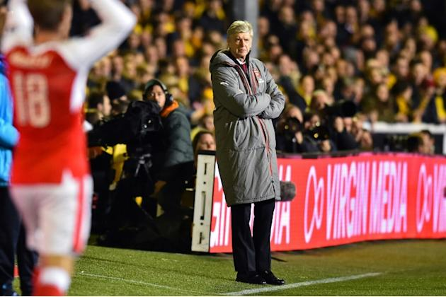 Arsenal's manager Arsene Wenger watches from the touchline on February 20, 2017