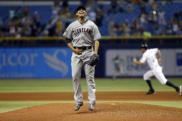 Pitcher Carlos Carrasco of the Cleveland Indians reacts on the mound after giving up a single to Joey Butler of the Tampa Bay Rays during the bottom of the ninth inning of a game on July 1, 2015 in St