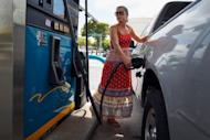 Lucy Crawford puts gas into her vehicle at a Valero station in Miami, Florida in May 2012. US consumer prices fell in May for the first time in two years, pulled down by falling gasoline prices, but the core inflation indicator picked up speed for a third straight month, the Labor Department reported Thursday