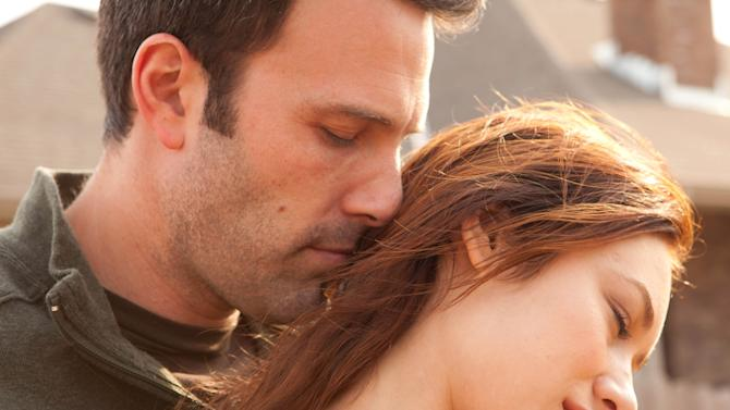 "This undated photo provided by Magnolia Pictures shows Ben Affleck and Olga Kurylenko in a scene from, ""To the Wonder."" (AP Photo/Magnolia Pictures, Mary Cybulski)"