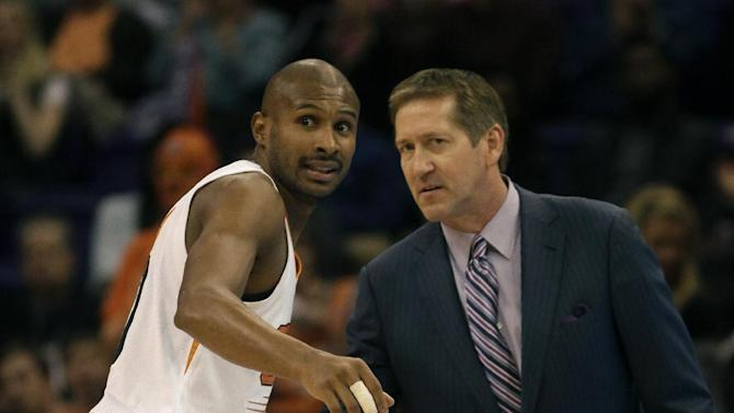 Phoenix Suns head coach Jeff Hornacek, right, talks to Leandro Barbosa (10) in the first quarter during an NBA basketball game against the Charlotte Bobcats, Saturday, Feb. 1, 2014, in Phoenix