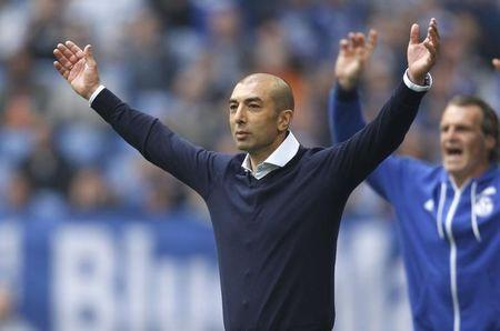 FC Schalke 04's coach Di Matteo celebrates a goal against VfB Stuttgart during their Bundesliga first division soccer match in Gelsenkirchen