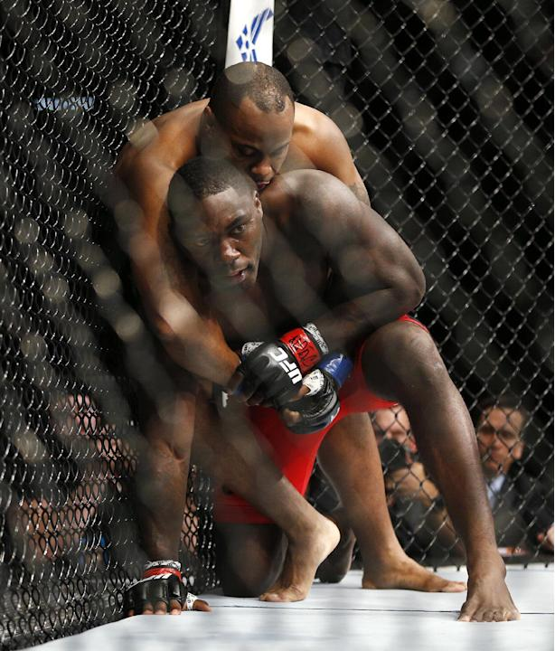 Daniel Cormier, top, wrestles with Anthony Johnson during their light heavyweight title mixed martial arts bout at UFC 187 on Saturday, May 23, 2015, in Las Vegas. (AP Photo/John Locher)