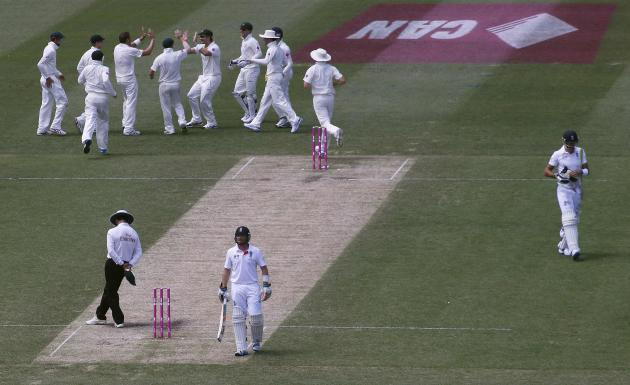 Australia's team celebrates after taking the wicket of England's Pietersen during the second day of the fifth Ashes cricket test at the Sydney cricket ground