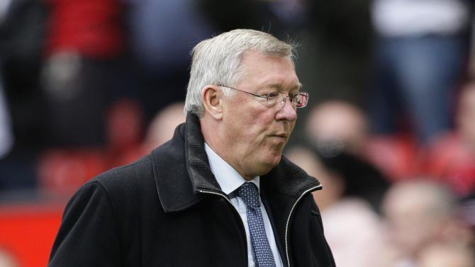 Manchester United's manager Sir Alex Ferguson walks from the pitch after his team's 6-1 loss to Manchester City in their English Premier League soccer match at Old Trafford Stadium, Manchester, England, Sunday Oct. 23, 2011. (AP Photo/Jon Super)