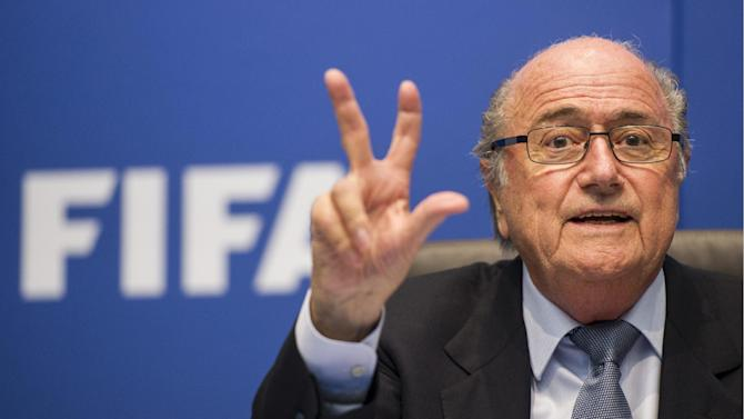 FIFA President Sepp Blatter gestures as he speaks to journalists following the FIFA Executive Committee meeting in Zurich, Switzerland, Friday, Oct. 4, 2013. Blatter said a final decision on which months to play the 2022 World Cup in Qatar might be delayed until 2015