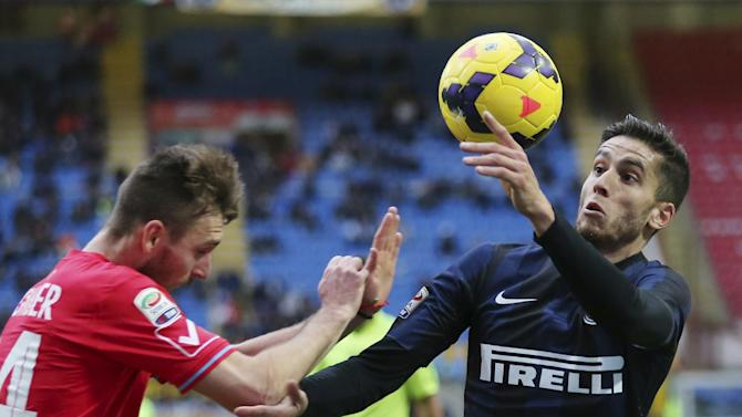 Inter Milan midfielder Ricardo Alvarez, right, of Argentina, challenges for the ball with Catania defender Norbert Gyomber, of Slovakia, during the Serie A soccer match between Inter Milan and Catania at the San Siro stadium in Milan, Italy, Sunday, Jan. 26, 2014