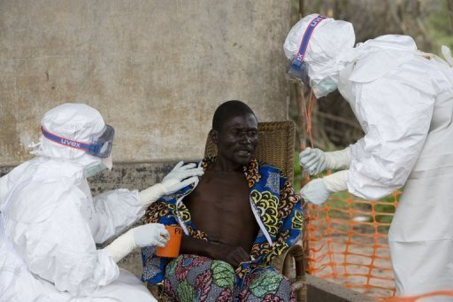 Nurses wearing protective clothing take care of a patient with Ebola haemorrhagic fever in Kampungu. An outbreak of Ebola fever in the Democratic Republic of Congo may have claimed up to 32 lives since May, according to the World Health Organisation.