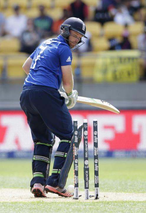 England's Bell looks back as he is bowled by Sri Lanka's Lakmal during their Cricket World Cup match in Wellington