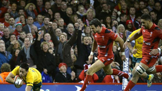 Australia's Lealiifano scores a try against Wales during their international rugby union match in Cardiff