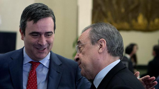 "Miguel Cardenal, head of the Superior Sports Council, Spain's top sporting body, left, slaps Real Madrid's President Florentino Perez's back after a breakfast sports meeting in a hotel in Madrid,  Spain, Thursday, Dec. 19, 2013. Spanish sports leaders are angry over a European Union probe targeting Real Madrid, Barcelona and five other top Spanish soccer clubs for possibly having received illegal state aid, and claim someone is out to attack Spanish football. Cardenal said Thursday the probe was causing ""grave damage "" to Spanish soccer's reputation and questioned the motives behind the EU investigation. Real Madrid president Florentino Perez was equally annoyed and said he believed ""there is a campaign against Spanish football."""